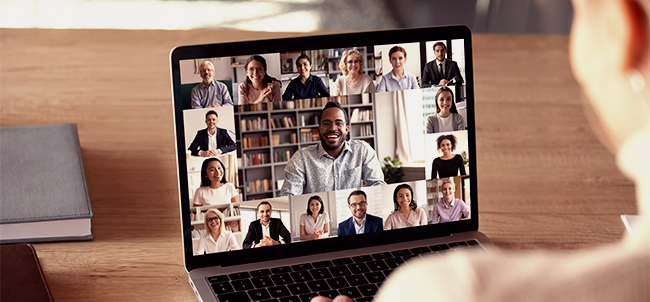 female employee speak talk on video call with diverse multiracial colleagues on online briefing, woman worker have online video conference with coworkers